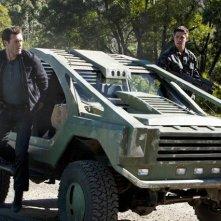Terra Nova: Jason O'Mara e Dean Geyer in una scena dell'episodio Now You See Me