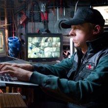 Simon Pegg alle prese con i suoi computer in una scena di Mission: Impossible - Protocollo Fantasma