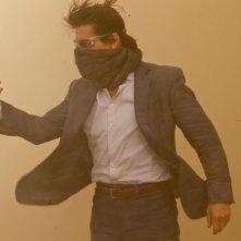 Tom Cruise in una polverosa immagine di Mission: Impossible - Protocollo Fantasma