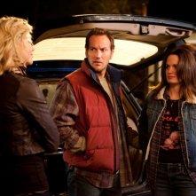 Charlize Theron in una scena di Young Adult insieme a Patrick Wilson e Elizabeth Reaser
