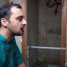 Un sanguinolento primo piano di Claudio Marmugi in Eaters