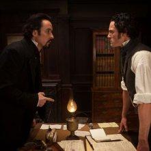 John Cusack insieme a Luke Evans in una scena del film The Raven