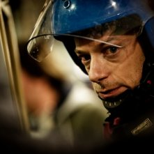 Filippo Nigro in tenuta antisommossa in una scena del film A.C.A.B.