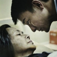 A Simple Life (Tao Jie): Deanie Yip e Andy Lau in una tenera e commovente scena del film