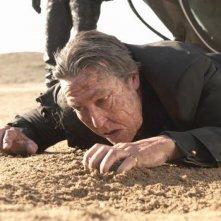 Ghost Rider: Spirito di vendetta, Ciarán Hinds a terra picchiato a sangue in una scena tratta dal film