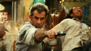 Viaggio in paradiso: Mel Gibson in azione in un momento dell'action movie diretto da Adrian Grunberg