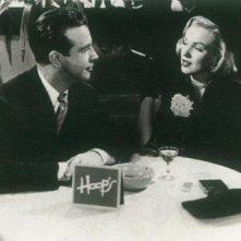 Marilyn Monroe con Dick Powell ne Il messicano