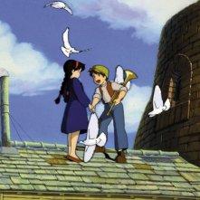 Pazu e Sheeta sul tetto insieme ai colombi in una scena del film Il castello nel cielo
