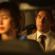 Taste of Money: Kim Hyo-jin (fuori fuoco) insieme a Darcy Paquet in un'immagine del film