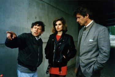 Roman Polanski: A Film Memoir, un'immagine di Roman Polanski sul set di Frantic, insieme a Harrison Ford ed Emmanuelle Seigner