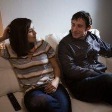 Qualche nuvola: Michele Alhaique sul divano in compagnia di Greta Scarano in una scena del film