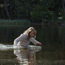 Babycall: Noomi Rapace in acqua in una scena del film