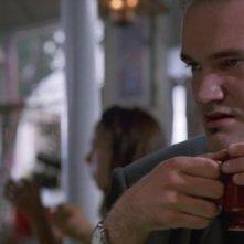 Quentin Tarantino è Mr. Brown in una scena de Le Iene