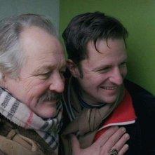 The Shine of Day: Walter Saabel abbraccia l'amico Philipp Hochmair in una scena del film