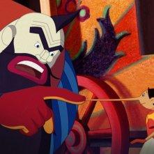 Pinocchio: Mangiafuoco e Pinocchio in una scena del film di Enzo d'Alò