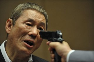 Outrage Beyond: il regista e interprete del film Takeshi Kitano in una scena del film