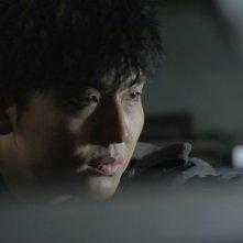 Pietà: lo sguardo malvagio di Lee Jung-jin in una scena del film