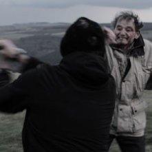Stan Rowe in una sequenza di Harold's Going Stiff
