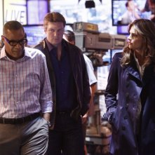 Castle: Tyrees Allen, Stana Katic e Nathan Fillion in una scena dell'episodio Cloudy With a Chance of Murder