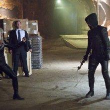Arrow: Kelly Hu, Ty Olsson e Stephen Amell in una scena dell'episodio Honor Thy Father della prima stagione