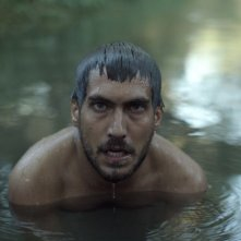 Beyond the Hill: Berk Hakman in acqua in una scena del film
