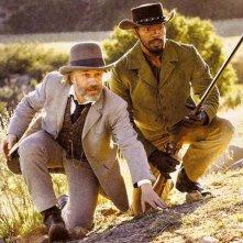 Christoph Waltz insieme a Jamie Foxx in una scena di Django Unchained