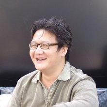 Judge Archer: il regista Xu Haofeng sorride sul set del film