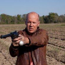 Bruce Willis in una scena di Looper nei panni di Old Joe