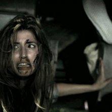 Non aprite quella porta 3D: Tania Raymonde in una scena dell'horror