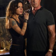 Jimmy Bobo - Bullet to the Head: Sylvester Stallone in una scena del film con Sarah Shahi