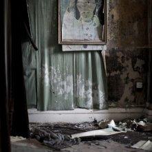 Mea maxima culpa. Silenzio nella casa di Dio: una foto di Giovanni Paolo II appesa nella chiesa di St. Joseph, nel nord di Belfast