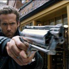 R.I.P.D.: Ryan Reynolds in una scena del poliziesco fantascientifico firmato da Robert Schwentke