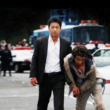 Shield of Straw: Takao Osawa con Tatsuya Fujiwara in una scena del film