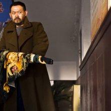 A Touch of Sin: Wu Jiang in una scena d'azione del film