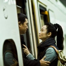A Touch of Sin: Zhao Tao in una scena del film insieme al suo amato Jiayi Zhang