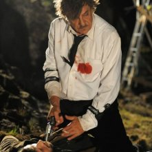 Ti ho cercata in tutti i necrologi: Giancarlo Giannini in azione in una scena del film