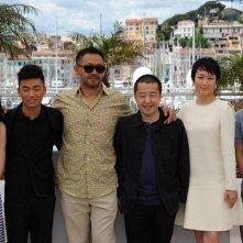 A Touch of Sin: A Touch of Sin: il regista Jia Zhang-ke con il cast del film durante il photocall a Cannes 2013