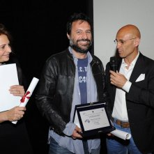 Premio La Pellicola d'Oro 2013 Premio Giovani - Centro Sperimentale di Cinematografia il direttore di produzione Attilio Moro premiato dal Dir. Generale del Centro Marcello Foti. Con loro, Cloris Bros