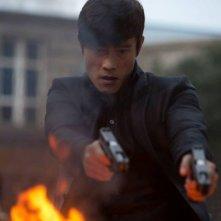 Red 2: Byung-Hun Lee nei panni di Han Cho Bai in una scena del film