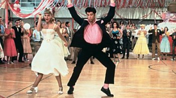 John Travolta e Olivia Newton-John in una scena del film Grease