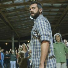 The Sacrament: Aj Bowen in una scena dell'horror