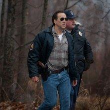 Nicolas Cage in azione in una scena del thriller Il cacciatore di donne