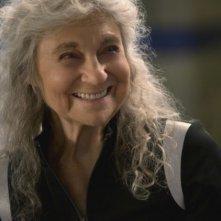 Hunger Games: la ragazza di fuoco - Un primo piano della sorridente Lynn Cohen
