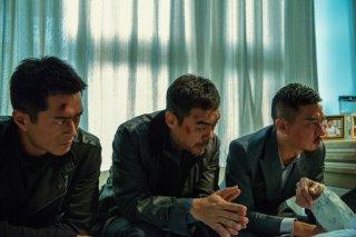 The White Storm: Louis Koo in una scena del film d'azione con Nick Cheung e Sean Lau