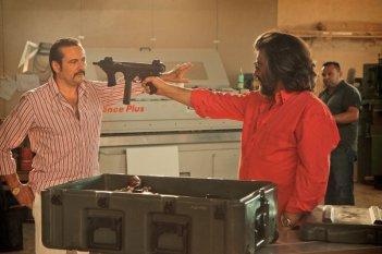 Roma Criminale: Corrado Solari in una scena con Luca Lionello