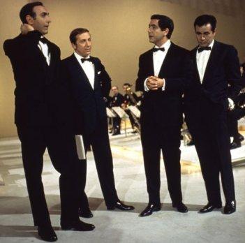 Quattro icone della televisione italiana: Mike Bongiorno, Corrado, Pippo Baudo ed Enzo Tortora.