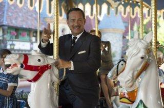 Saving Mr. Banks: Tom Hanks sorride sulla giostra in una scena del film