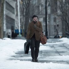 A proposito di Davis: Oscar Isaac nei panni di un cantautore folk in una scena del film