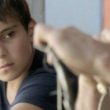 Macondo: il piccolo Ramasan Minkailov, protagonista del film in una scena