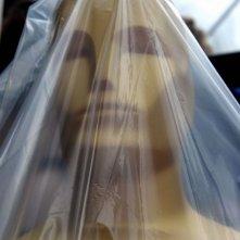 Oscar 2014 - una delle statue esterne protetta con un telo antipioggia.